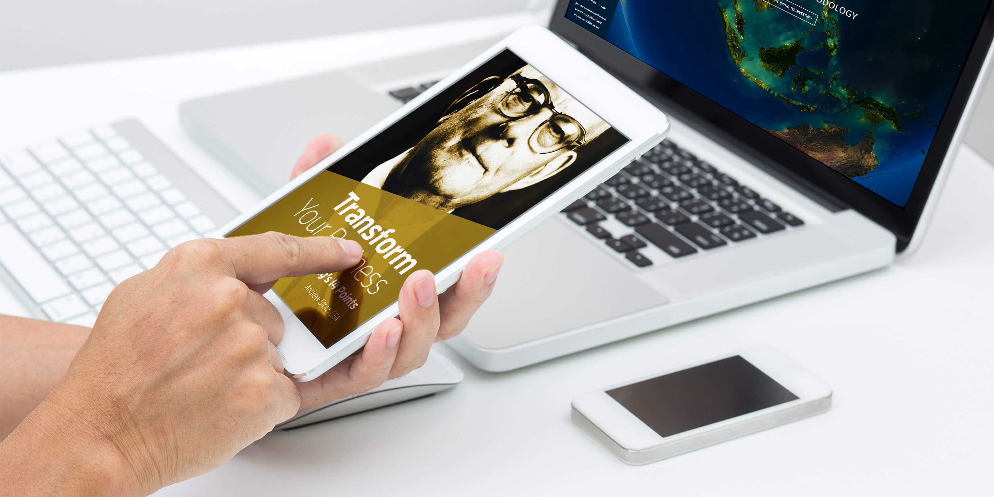 Man hands holding tablet  with laptop computer background